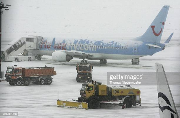 A snowplough clear the snowcovered runway of the Airport Stuttgart on January 24 2007 in Stuttgart Germany After warmer temperatures than usual in...