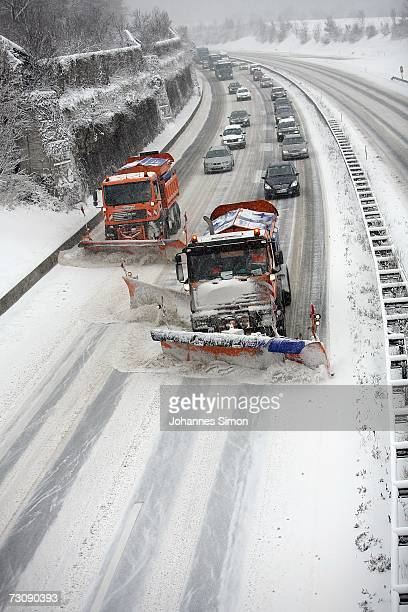 Snowploughs clear the snowcovered motorway A96 near Windach west of Munich on January 24 2007 in Bavaria Southern Germany After warmer temperatures...