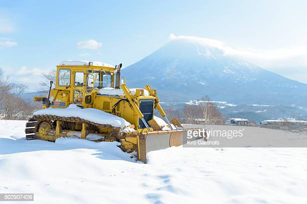 Snowplow and Mt Yotei on a blue sky day