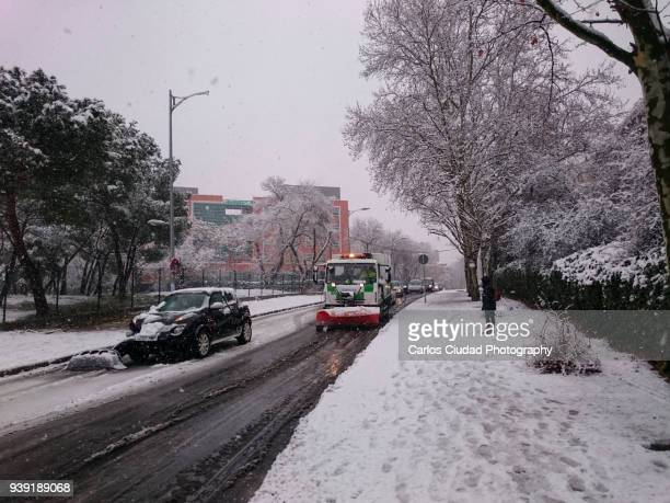 Snowplow and traffic accident in Madrid (Spain) during snowstorm