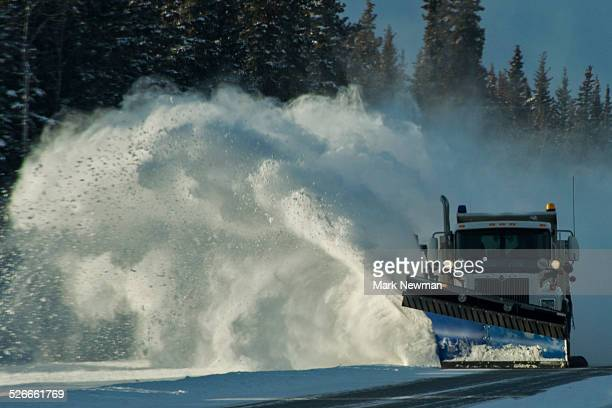 snowplow blowing snow off road - snowplow stock pictures, royalty-free photos & images
