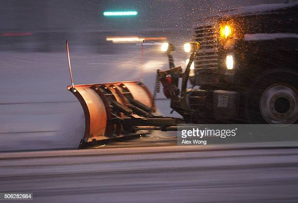 A snowplow cleans up snow on a street January 22 2016 in Washington DC A winter snowstorm is forecasted for the East Coast this weekend with...