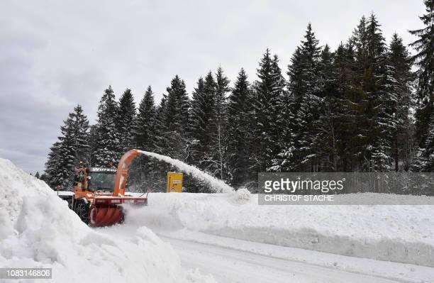 Snowplow clears a road near the small Bavarian village of Kruen near Garmisch-Partenkirchen, southern Germany, on January 15, 2019.