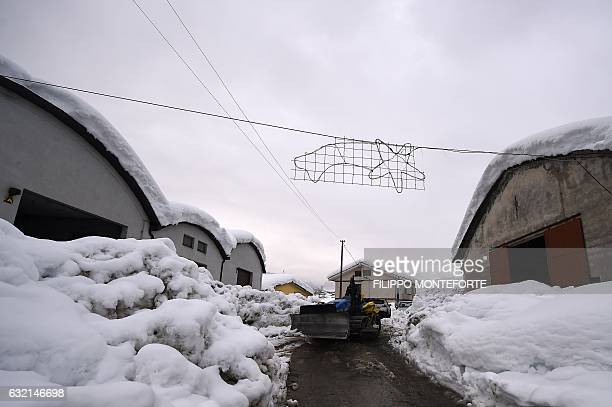 Snowplow clears a snow-covered road in the village of Penne, after an avalanche engulfed the mountain hotel Rigopiano in Farindola, in...