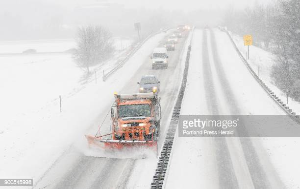 A snowplow clears the Maine Turnpike Approach in South Portland Friday December 22 2017