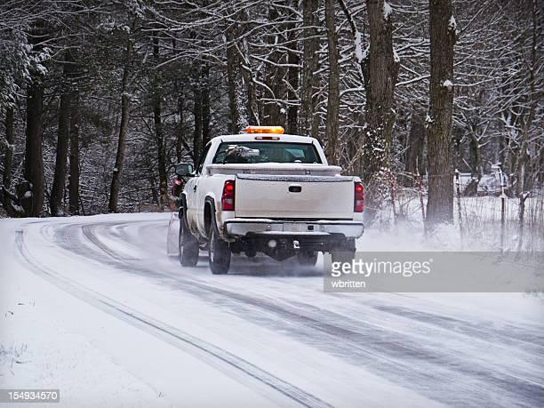 Snowplow on icy road