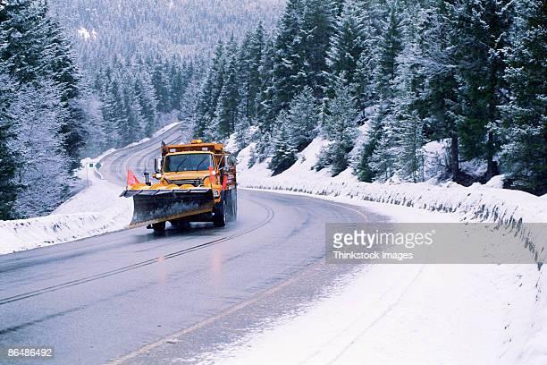 snowplow on winter road - schneefahrzeug stock-fotos und bilder