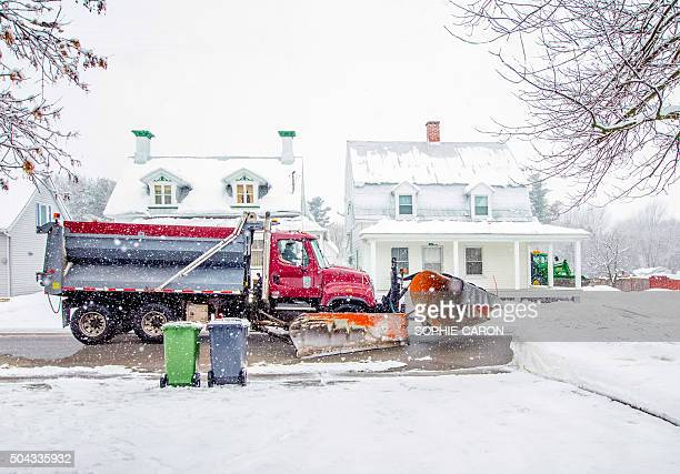 snowplow passing two garbage bins and recycling . - chilly bin stock photos and pictures