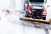 Snowplow removing the Snow from Highway during a Snowstorm