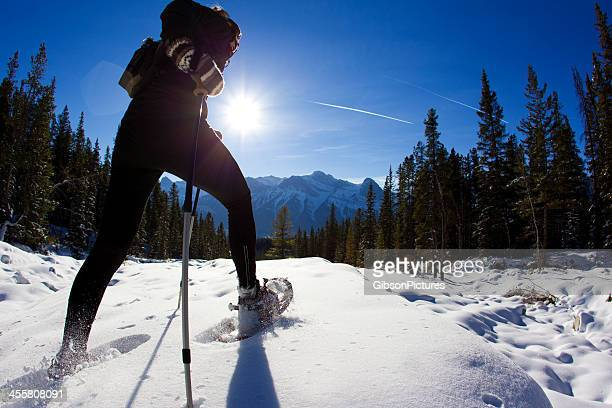 snowshoe adventure - striding stock pictures, royalty-free photos & images