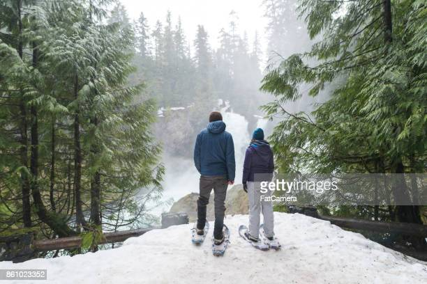 snowshoeing adventure! - national forest stock pictures, royalty-free photos & images