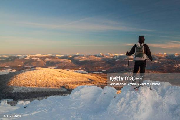 snowshoeing on big white mountain, british columbia, canada - kelowna stock pictures, royalty-free photos & images