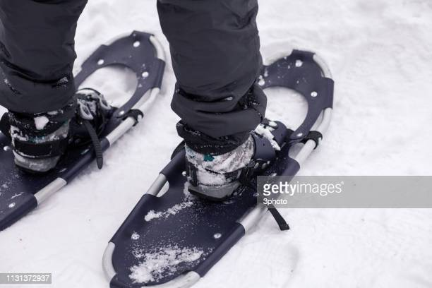 Snowshoeing On Snowcapped Mountain