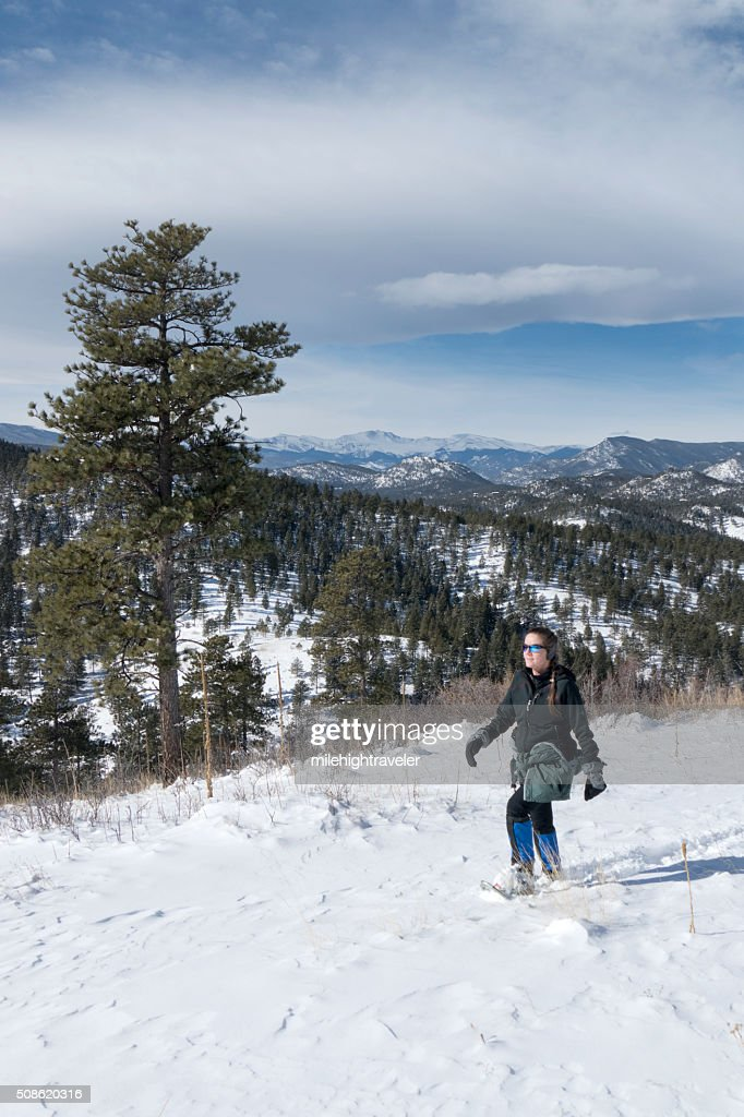 Snowshoeing snowy mountain trail and Mount Evans Colorado : Stock Photo
