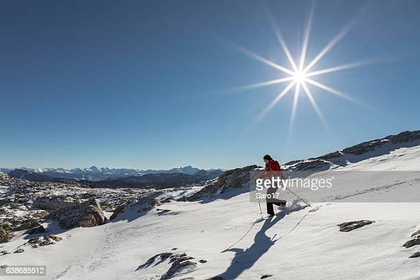 Snowshoeing under the winter sun, Austria