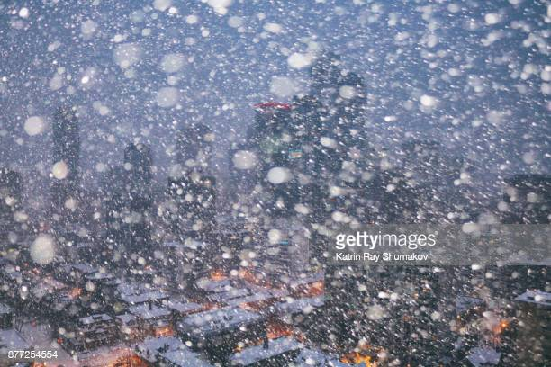 snowstorm drama in the city - snow storm stock photos and pictures