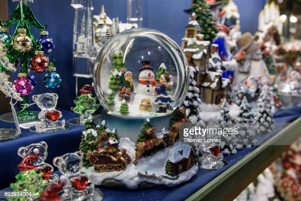 Snowstorm globes and other Christmas decorations pictured at the annual Christmas market at Roemerberg on December 16 2017 in Frankfurt Germany...