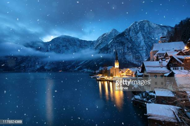 snowstorm in hallstatt - mere noel stock pictures, royalty-free photos & images