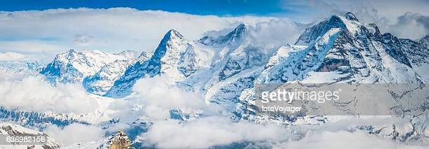 Snowy Alpine peaks Eiger overlooking cable car station Alps Switzerland