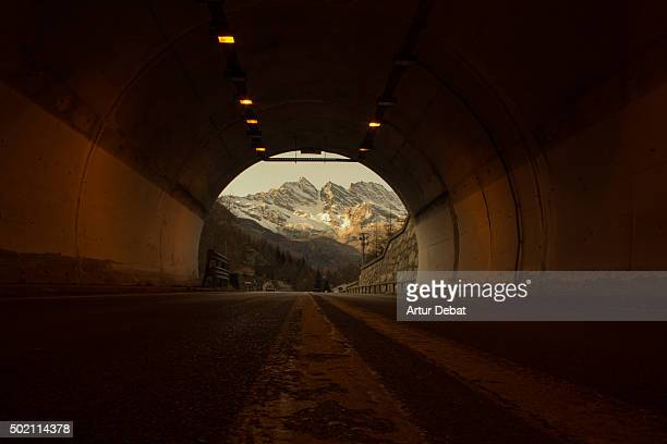 Snowy alps view in the Gran Paradiso national park from inside the tunnel with nice frame.