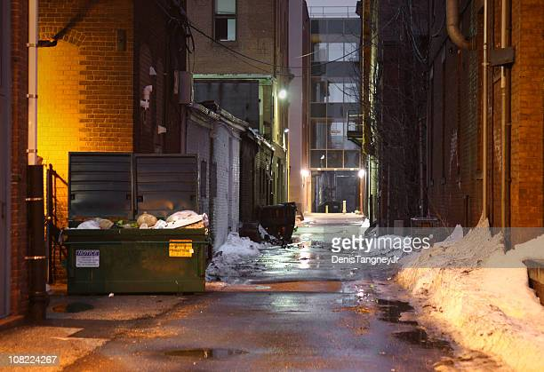 Snowy and Dark, Grunge Alley with Lights Shining at Night