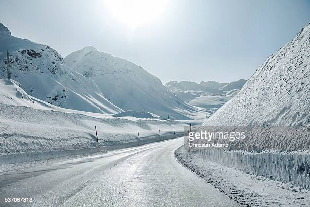 Snowy and sunny curvy mountain road