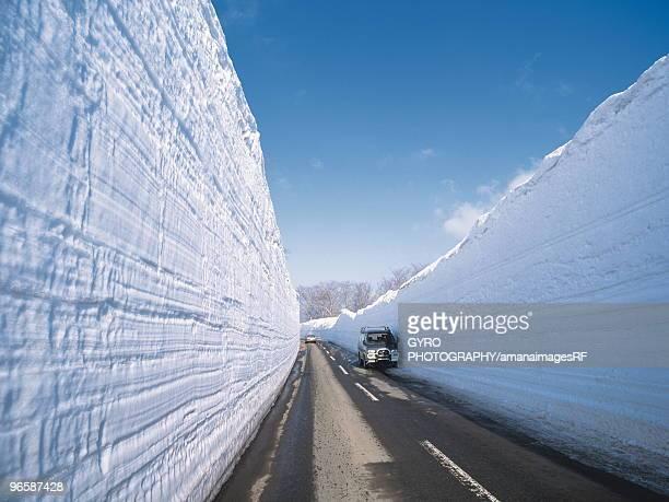 a snowy corridor in the aomori prefecture,  japan - aomori prefecture stock pictures, royalty-free photos & images