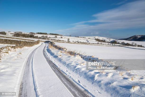 Snowy country lane in the English countryside