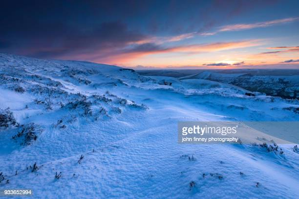 Snowy dawn from Kinder Scout in the Peak District National Park, UK.