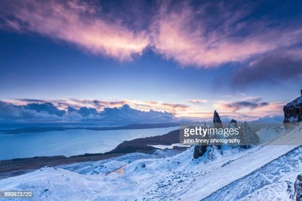 Snowy dawn on The Storr. Isle of Skye, Scotland, UK.