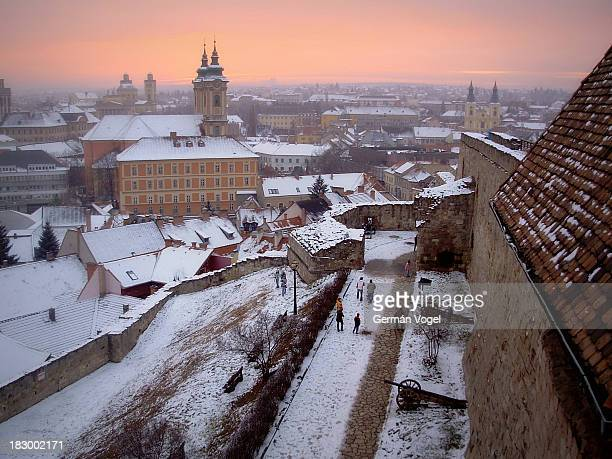 Snowy dusk of Eger skyline from the top of the Eger castle wall. This was one of the battle fronts that brought together Orthodox Christians ,...
