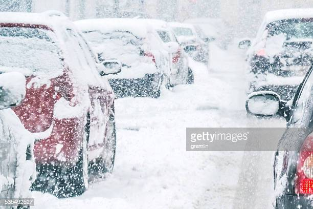 snowy european day traffic - blizzard stock pictures, royalty-free photos & images