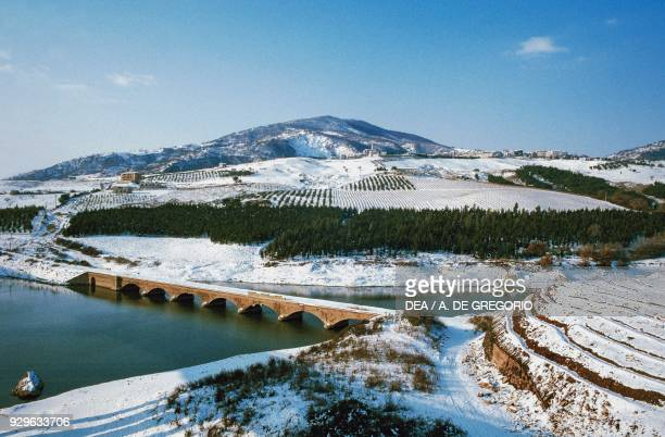 Snowy farmland along the banks of the Biferno river, Molise, Italy.