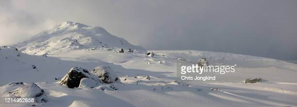 snowy hill and rocks in winter - land stock pictures, royalty-free photos & images