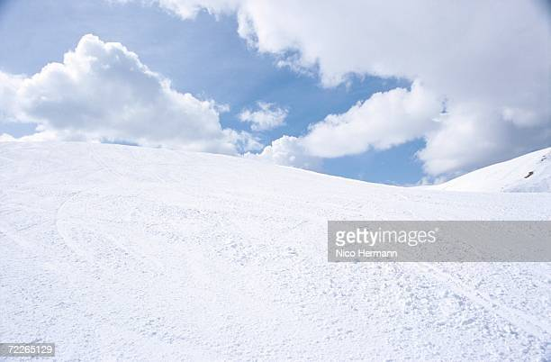 snowy hills under cloudy sky - hill stock pictures, royalty-free photos & images