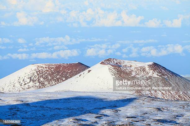 Snowy hilltops and blue sky