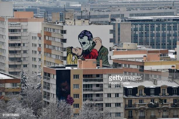 Snowy landscape and mural painting in 13th Paris HLM district on february 07 2018 in Paris France