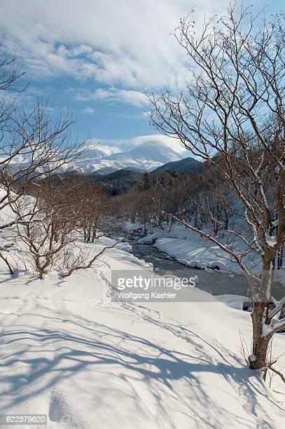 Snowy landscape in the winter with the volcanic Shiretoko mountain range and river in Abashiri Shiretoko National Park Shiretoko Peninsula on...
