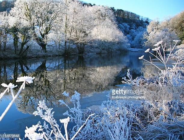 snowy landscape on  river bank - glamorgan stock pictures, royalty-free photos & images