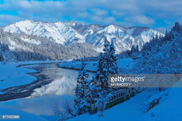 snowy mountain and a river - miyamoto y ストックフォトと画像