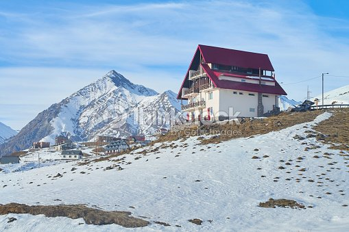 Snowy Mountain Hotel Or House On The Top Of Peak Stock Photo