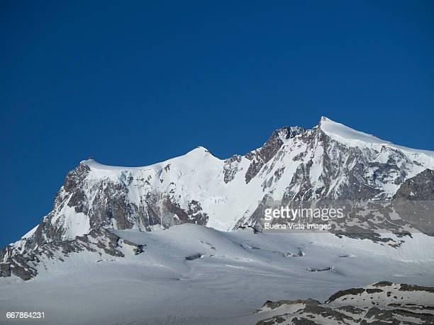 snowy mountain in the alps - monte rosa foto e immagini stock
