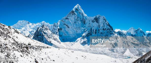 snowy mountain peak high in himalayas everest national park panorama - snowcapped mountain stock pictures, royalty-free photos & images