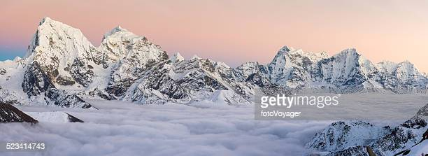 Snowy mountain peaks panorama soaring above the clouds Himalayas Nepal