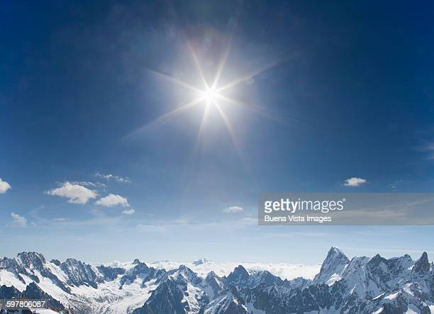 snowy mountain range under sunshine - monte bianco foto e immagini stock