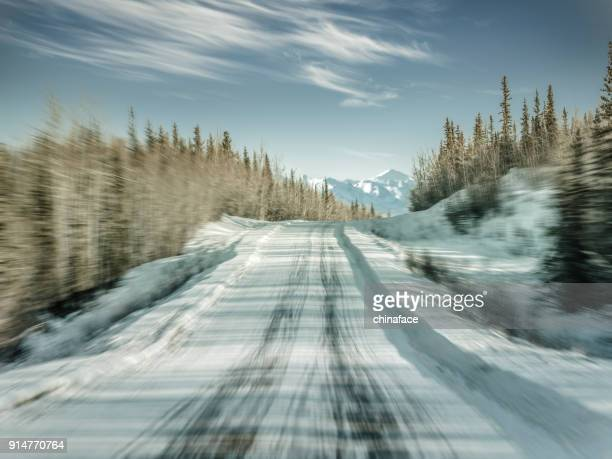 snowy mountain road,blurred motion