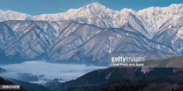 Snowy mountains and Hakuba village covered with clouds