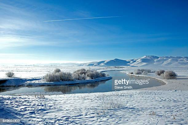 snowy mountains and river in remote landscape - sun valley idaho stock photos and pictures