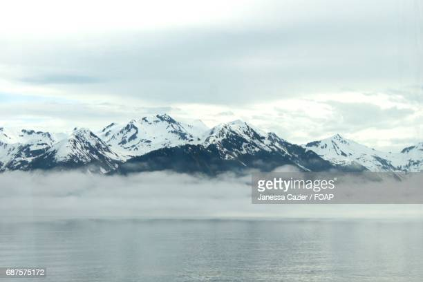 snowy mountains in foggy weather - janessa stock pictures, royalty-free photos & images