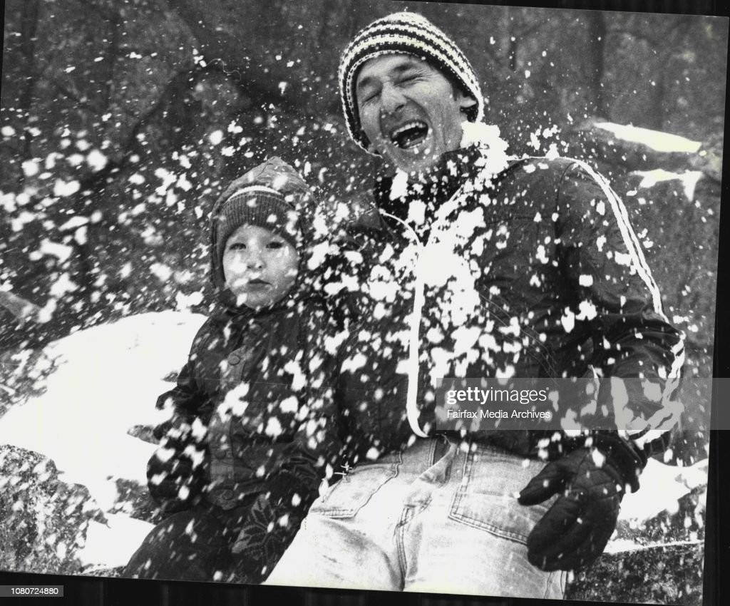 Snowy Mountains -- Mr. Graham Curtis of Seven Hills and son, Ashley, 2, are hit by a snowball at Thredbo. : News Photo